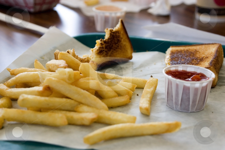 Close up on French Fries stock photo, Close up shot of French Fries, Toast and Ketchup by Mehmet Dilsiz