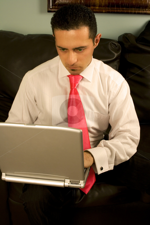 Businessman Working on the Couch stock photo, Businessman Working on his Laptop Sitting on the Couch by Mehmet Dilsiz