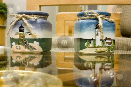 Lighthouse Candle Holders on glass table stock photo, Lighthouse Candle Holders on glass table in a doctor's office by Mehmet Dilsiz