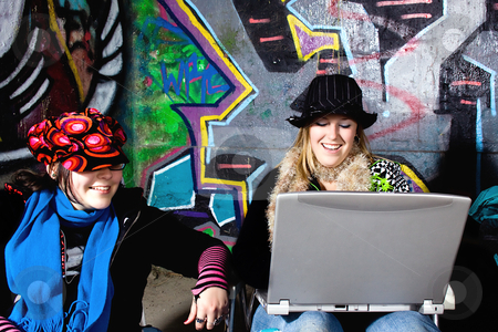 Teenager with a Laptop stock photo, Teenager with a Laptop Looking at the Computer by Mehmet Dilsiz