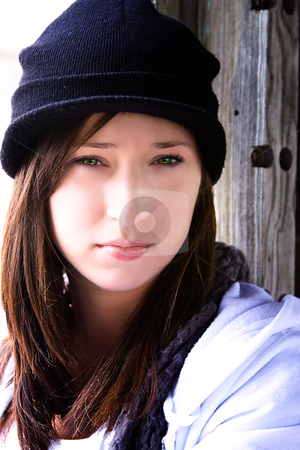 Beautiful Teenager with a Hat stock photo, Close up on a Beautiful Teenager Sitting on an Old Abandoned Train by Mehmet Dilsiz