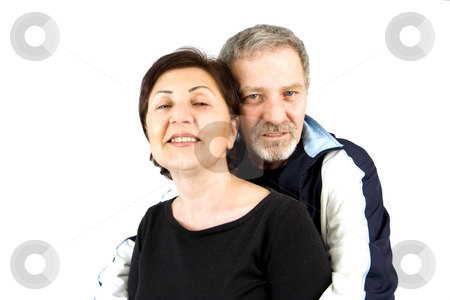 Couple Hugging while Looking At the Camera stock photo, Couple Hugging while Looking At the Camera - Isolated by Mehmet Dilsiz