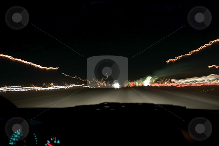 Highway Traffic and Lights at Night stock photo, Shot of a higway and car lights taken from the car with a tripod while travelling. by Mehmet Dilsiz