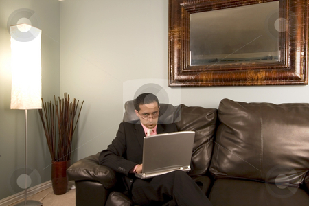 Home or Office - Businessman Working on the Couch stock photo, Home or Office - Businessman Sitting on the Couch with a Laptop by Mehmet Dilsiz