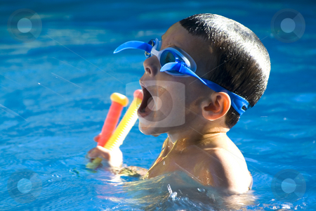 Little Boy in the Swimming Pool stock photo, Little boy in the swimming pool with his mouth open trying to get water in his mouth by Mehmet Dilsiz