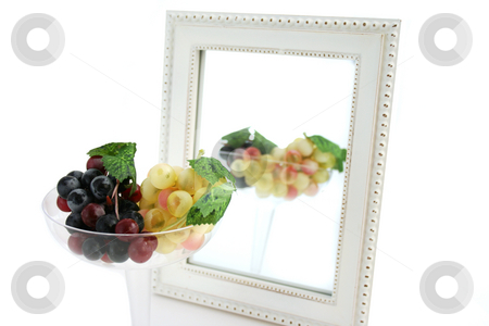 Isolated Grapes In a Glass stock photo, Isolated Grapes In a Glass in front of a Mirror by Mehmet Dilsiz