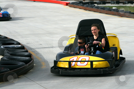 Brother and Sister on the Go Cart stock photo, Brother and Sister racing on the Go Cart by Mehmet Dilsiz