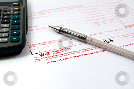 Preparing Taxes stock photo, Preparing Taxes - Form W2 for 2008 by Mehmet Dilsiz