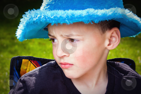 Little Kid Looking Away stock photo, Little Kid Looking Away with a Sad Expression by Mehmet Dilsiz