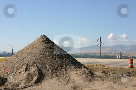 Sand Pile in Construction Site stock photo, Sand Pile in Construction Site by the Road by Mehmet Dilsiz