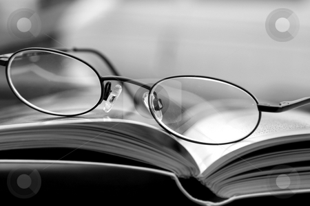 Black and White - Glasses and the Magazine stock photo, Black and White Close up on the Glasses and the Magazine by Mehmet Dilsiz