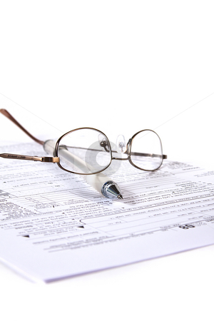 Preparing Taxes stock photo, Preparing Taxes - Form 1040 for 2008 by Mehmet Dilsiz