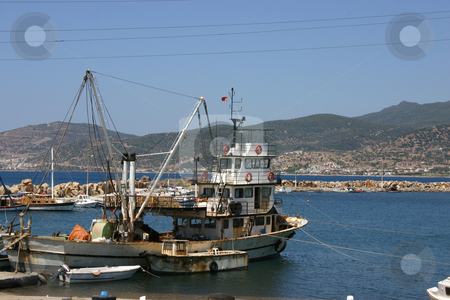 Fishing Boat in Marina stock photo,  by Mehmet Dilsiz