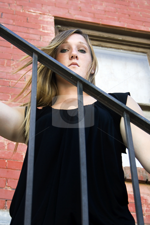 Beautiful Girl posing outdoors on stairs in the City stock photo, Beautiful Girl in Black dress posing outdoors in the City - Urban by Mehmet Dilsiz