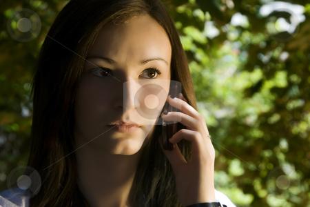 Beautiful Girl Talking on the Phone stock photo, Close up on a Beautiful Girl Talking on a Cell Phone by Mehmet Dilsiz