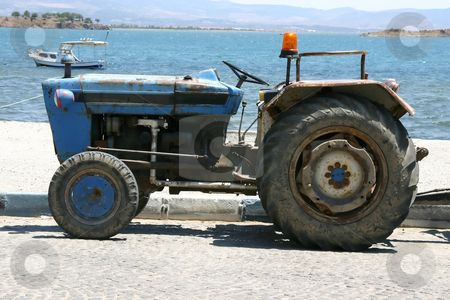 Tractor by the beach stock photo, Tractor by the Beach in Turkey by Mehmet Dilsiz