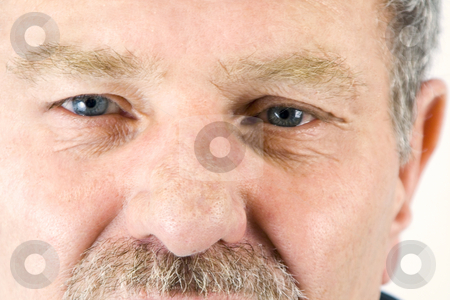 Close up on the face of a baby boomer stock photo,  by Mehmet Dilsiz