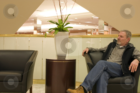 Resting on the chair during shopping stock photo, Resting on the chair, taking a break from shopping by Mehmet Dilsiz