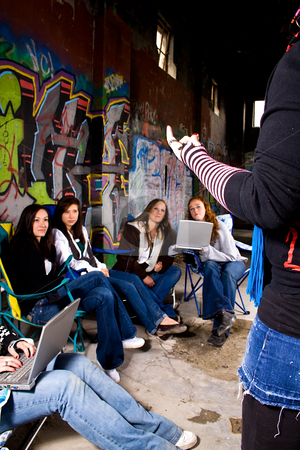 Lecturing Teeangers stock photo, One Teenager talking to the others in a support group by Mehmet Dilsiz