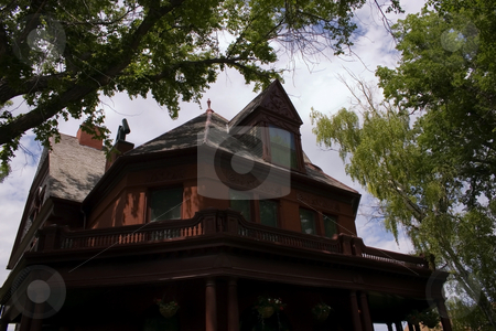 Old Governer's Mansion in Helena Montana stock photo, Original Governer's Mansion in Helena Montana under the Trees by Mehmet Dilsiz