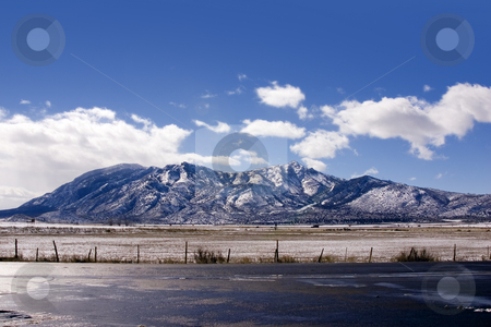 Mountains on my Backyard in Winter stock photo, Snowy Mountains in Winter by Mehmet Dilsiz