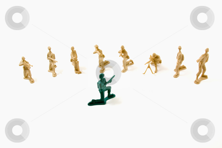 Stubborn Concept - Plastic Army Men stock photo, Isolated Plastic Toy Soldiers - Stubborn Concept by Mehmet Dilsiz