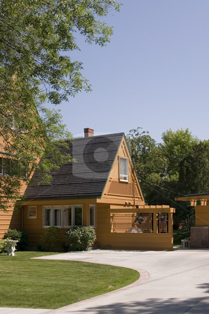 Front of a House and its Driveway with Blue Skies on the Backgro stock photo, House and its Driveway with Blue Skies on the Background by Mehmet Dilsiz