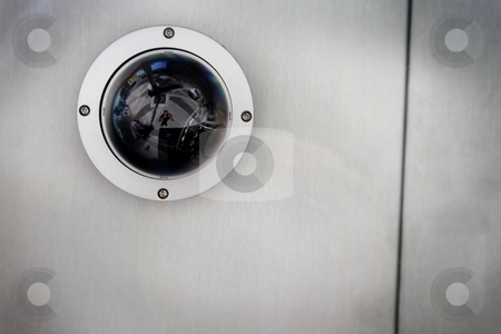 Security Camera stock photo, Round security camera in a silver metal ceiling. by Henrik Lehnerer
