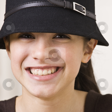 Girl Wearing Hat stock photo, A young girl is wearing a hat and smiling at the camera.  Square composition. by Jonathan Ross