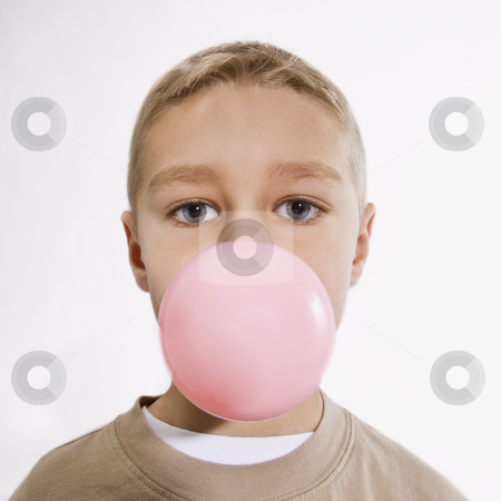 Boy Blowing Bubble with Bubble Gum stock photo, A young boy is chewing bubble gum and blowing a bubble.  He is looking at the camera.  Vertically framed shot. by Jonathan Ross