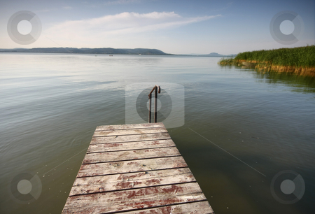 Pier in lake stock photo, Pier in lake with clear water by Istv??n Cs??k