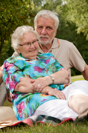 Senior couple loving eachother stock photo, Elderly couple enjoying the spring in the park by Frenk and Danielle Kaufmann