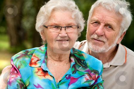 Happy Senior couple portrait stock photo, Elderly couple enjoying the spring in the park by Frenk and Danielle Kaufmann