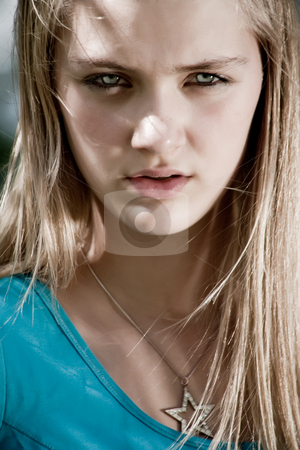 Flaming portrait stock photo, Teenage girl in fresh and happy mood outside in the park by Frenk and Danielle Kaufmann
