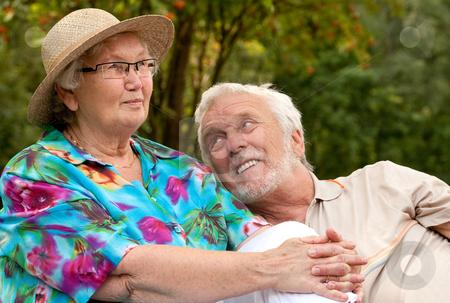 Senior couple enjoying the good weather stock photo, Elderly couple enjoying the spring in the park by Frenk and Danielle Kaufmann