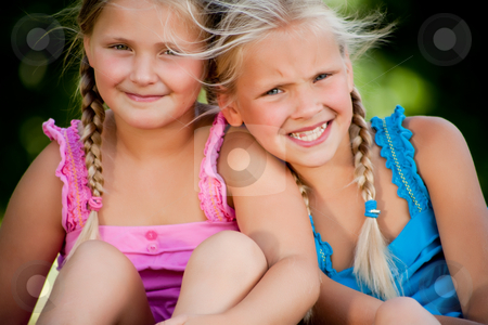 Happy twins stock photo, Two little girls in fresh colors in the park by Frenk and Danielle Kaufmann
