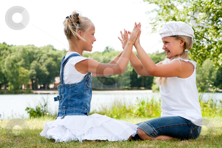 Play with the hands stock photo, Two little girls in fresh colors in the park by Frenk and Danielle Kaufmann
