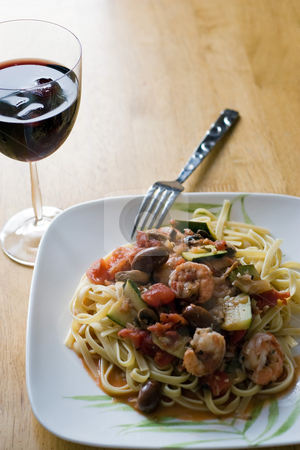 Shrimp with Pasta Dish stock photo, A delicious shrimp and pasta dish along with a glass of red wine. by Todd Arena