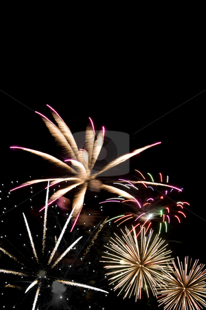 Beautiful Fireworks stock photo, Beautiful fireworks exploding over a dark night sky. Plenty of copyspace. by Todd Arena