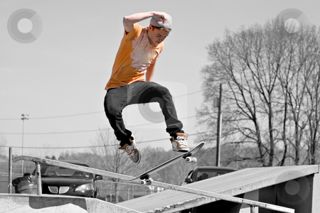 Skateboard Ramp stock photo, Portrait of a young skateboarder skating on a ramp at the skate park. by Todd Arena