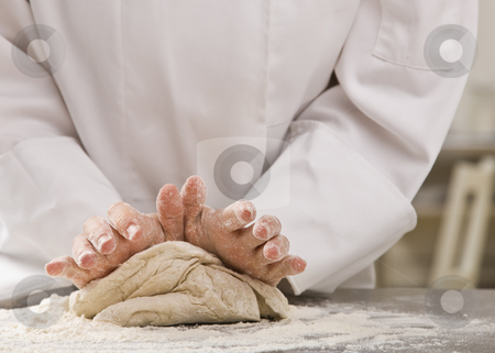 Chef kneading dough. stock photo, Chef standing over counter and kneading dough. Horizontal. by Jonathan Ross