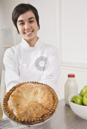 Attractive woman holding pie. stock photo, Attractive woman showing pie to the camera and smiling. Vertical. by Jonathan Ross