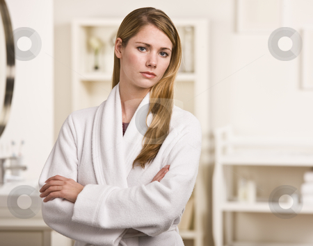 Attractive blonde in robe. stock photo, Attractive blonde woman in white robe facing the camera with her arms crossed.Horizontal. by Jonathan Ross