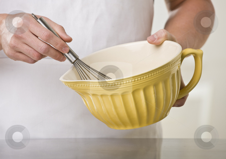 Man with whisk and bowl. stock photo, Man using whisk and mixing bowl. Horizontal by Jonathan Ross