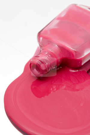 Nail Polish Spilling on a Mirror stock photo, Isolated Nail Polish Spilling on a Mirror by Mehmet Dilsiz