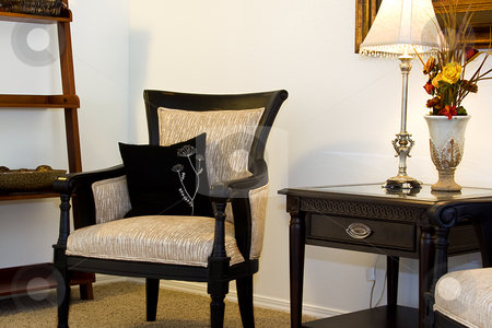 Family Room with Reading Chair and night stand stock photo, Close up on a corner of a house with a chair and nightstand by Mehmet Dilsiz