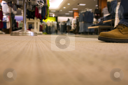 Shopping Mall - a customer shoping - floor view stock photo, Shopping mall, man walking in front of the camera - floor view by Mehmet Dilsiz