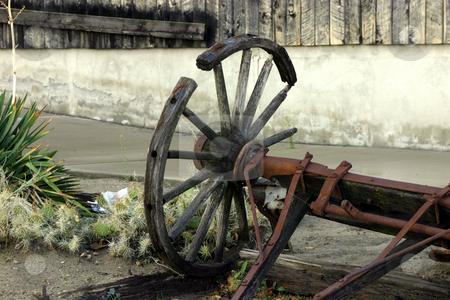 Old Antique & Broken Wagon Wheel stock photo, Close up on an Old Antique & Broken Wagon Wheel by Mehmet Dilsiz