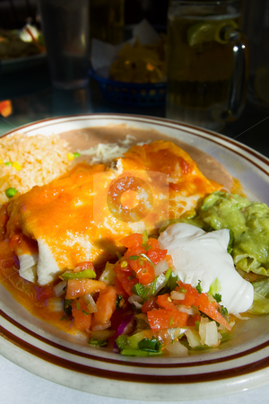 Close up on a Mexican Dish - Burrito stock photo, Close up on a Mexican Food with Beed in the background by Mehmet Dilsiz