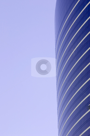 Clear Skies and A Skyscraper stock photo, Close up on Clear Skies and A Skyscraper by Mehmet Dilsiz